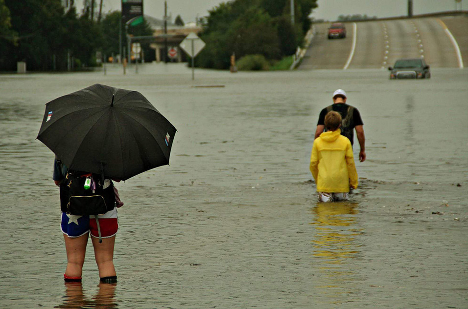 A woman stands in a flooded Houston street Aug. 27, 2017, amid the lingering rains brought from Hurricane Harvey. (Sgt. Steve Johnson, U.S. Army)